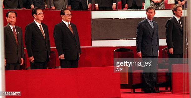 Chinese Vicepremiere Qian Qichen Premier Li Peng and President Jiang Zemin Britain's Prince Charles and Prime Minister Tony Blair stand to attention...