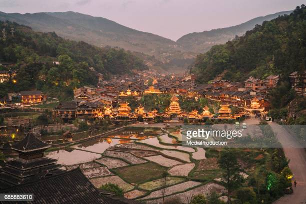Chinese village with rice terraces at sunrise