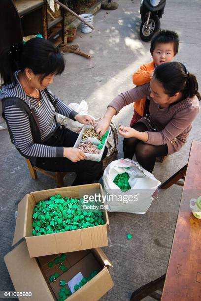 chinese villagers assembly computer connectors - changzhou stock pictures, royalty-free photos & images