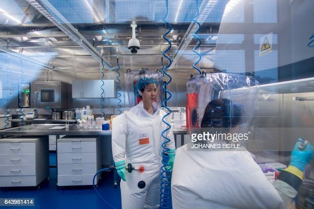 Chinese virologist Shi Zhengli is seen inside the P4 laboratory in Wuhan capital of China's Hubei province on February 23 2017 The P4 epidemiological...