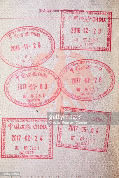 chinese visa stamps in passport - passport stamp stock photos and pictures