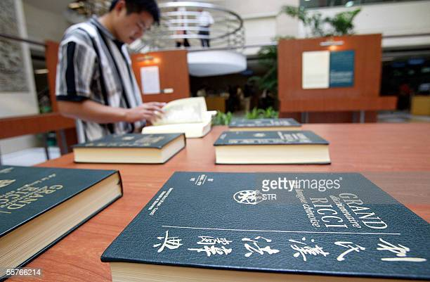 Chinese visitor browses the Grand Ricci dictionary which features manuscripts of the Grand Ricci a sevenvolume encyclopaedic dictionary compiled by...