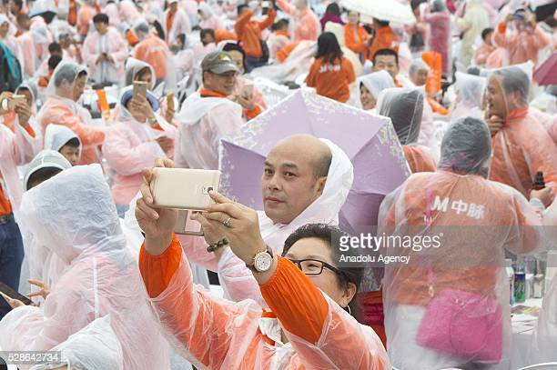 Chinese visitor takes selfie as South Koreas capital Seoul is bustling with a huge group of tasting samgyetang in Seoul South Korea on May 6 2016...