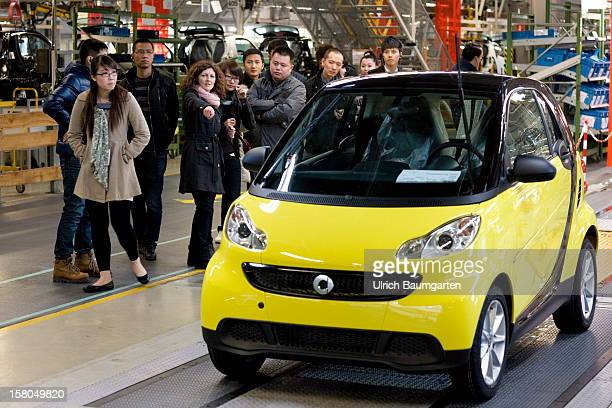Chinese visitors at the Daimler AG assembly line of the Smart Fortwo Electric Drive car at the company's Smartville plant on December 6 2012 in...