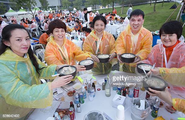 Chinese visitors attend event of samgyetang tasting as South Koreas capital Seoul is bustling with a huge group of tasting samgyetang in Seoul South...