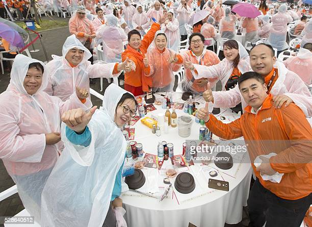 Chinese visitors enjoy with their samgyetang as South Koreas capital Seoul is bustling with a huge group of tasting samgyetang in Seoul South Korea...