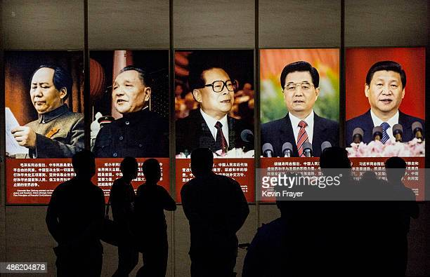 Chinese visitors looks at a display showing the five leaders of Communist China during a visit to the Museum of the War of Chinese People's...