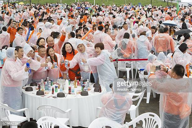Chinese visitors take photos as South Koreas capital Seoul is bustling with a huge group of tasting samgyetang in Seoul South Korea on May 6 2016...