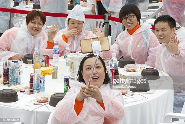 Chinese visitors take selfieas South Koreas capital Seoul is bustling with a huge group of tasting samgyetang in Seoul South Korea on May 6 2016...