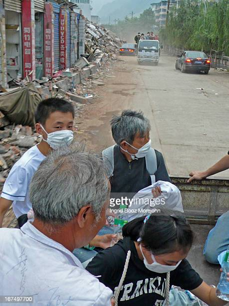 Chinese volunteer doctors and assistants hitch ride into earthquake zone, near city of Hanwang, in the aftermath of the May 12th, 2008 Wenchuan...