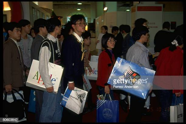 Chinese w US Apple Microsoft Windows 95 Packard Bell Japanese NEC shopping bags on line at computer exhibition re for trade investment