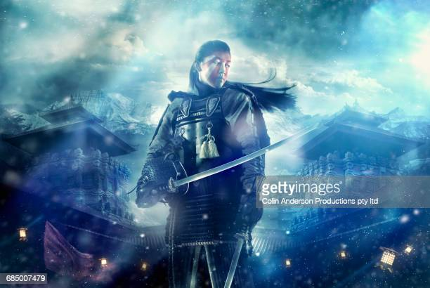 chinese warrior holding swords on foggy battlefield - warrior person stock photos and pictures
