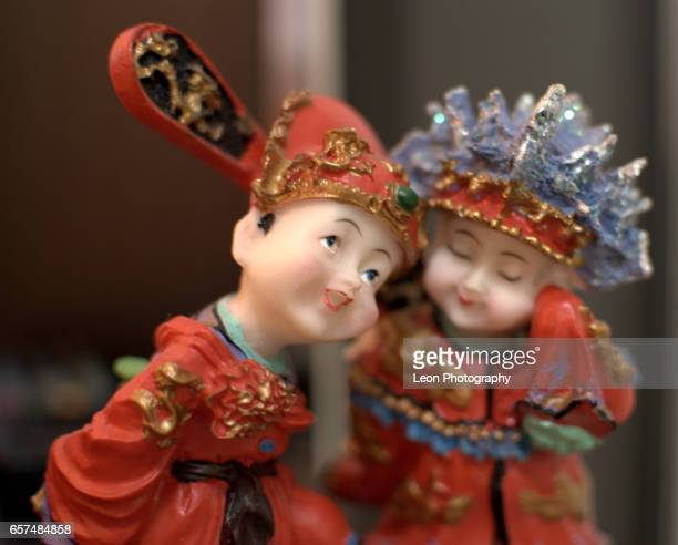 chinese wedding toys - dolly golden stock pictures, royalty-free photos & images