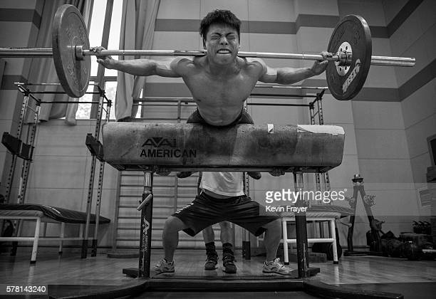 Chinese weightlifter Chen Lijun who competes in the 62 kg weightclass exercises with weights during a training session in preparation for the Rio...