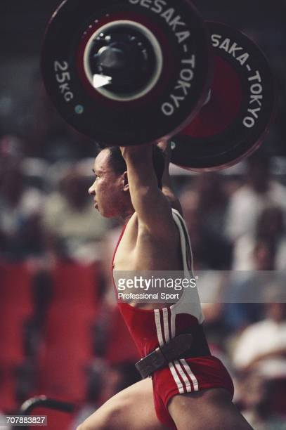 Chinese weightlifter Lin Qisheng pictured in action for China to finish in second place to win the silver medal in the Men's flyweight weightlifting...