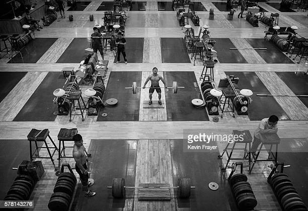 Chinese weightlifter Long Qingquan who competes in the 56 kg weigthclass lifts during a training session in preparation for the Rio Olympics at the...