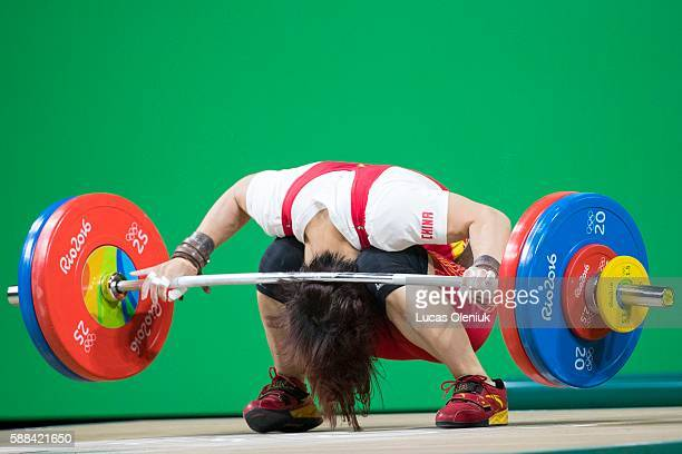 Chinese weightlifter Yanmei Xiang falls to the ground with the bar hitting the back of her neck during the snatch portion of the women's 69kg...