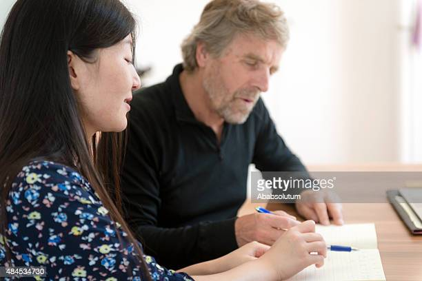 Chinese Woman and Srenior Caucasian Studying Chinese Numbers, Slovenia, Europe