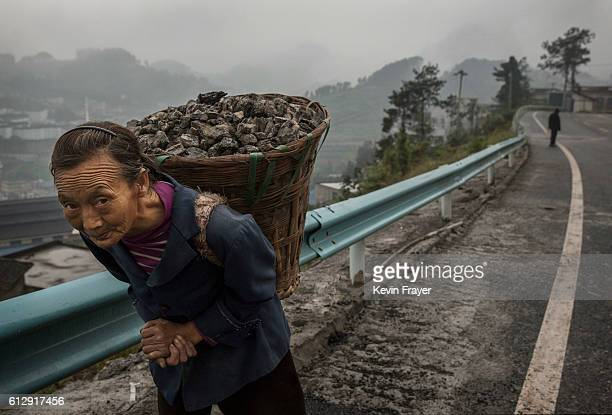 Chinese woman carries coal in the hills above the Chishui River the main water source used in locally made wine called baijiu on September 21 2016 in...