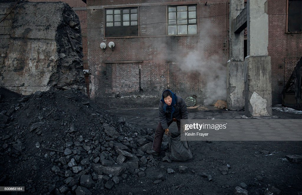 A Chinese woman collects coal in a sorting area at a coal mine on November 25, 2015 in Shanxi, China. A history of heavy dependence on burning coal for energy has made China the source of nearly a third of the world's total carbon dioxide (CO2) emissions, the toxic pollutants widely cited by scientists and environmentalists as the primary cause of global warming. China's government has publicly set 2030 as a deadline to reach the country's emissions peak, and data suggest the country's coal consumption is already in decline.
