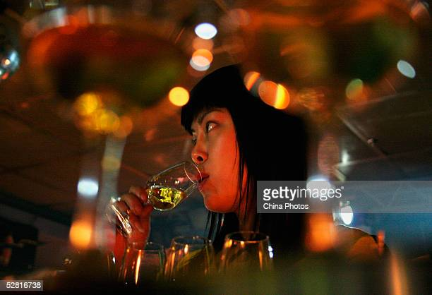 A Chinese woman drinks whisky at the Johnnie Walker Black Label Tasting Party on May 12 2005 in Chengdu of Sichuan Province China Johnnie Walker is...