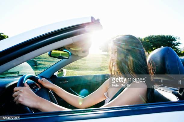 Chinese woman driving convertible