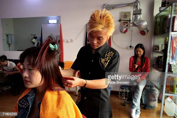 Chinese woman gets her hair done at a hair salon August 3 2006 in the new section of Lhasa in the Tibet Autonomous Region China Lhasa's face is ever...