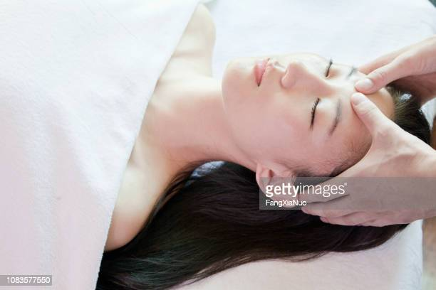 Chinese woman having massage in spa