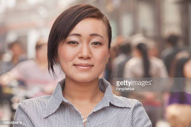 Chinese woman in downtown standing