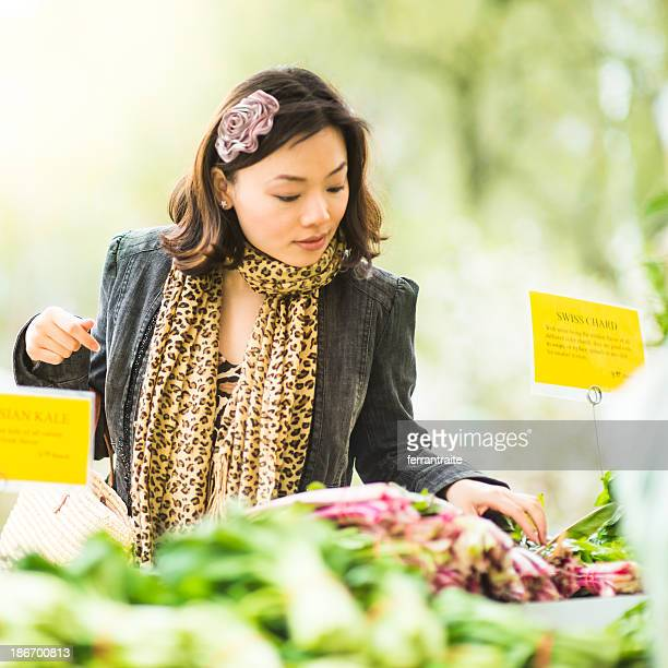chinese woman in farmers market - union square new york city stock pictures, royalty-free photos & images
