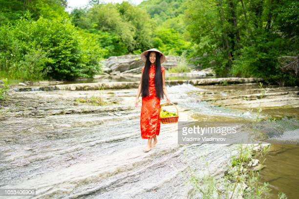 elegant chinese woman traditional dress carrying