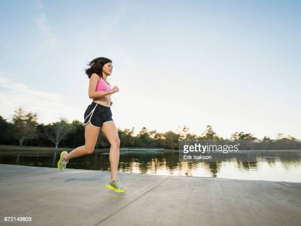 Chinese woman jogging in park