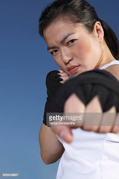 Chinese woman kick boxing outdoors