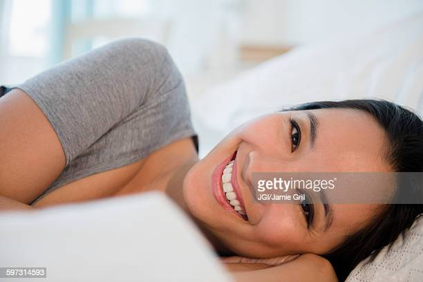 Chinese woman laying on bed