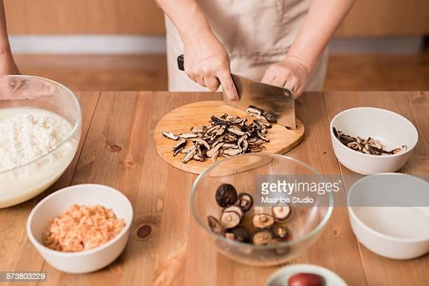 Chinese woman making Rice budding
