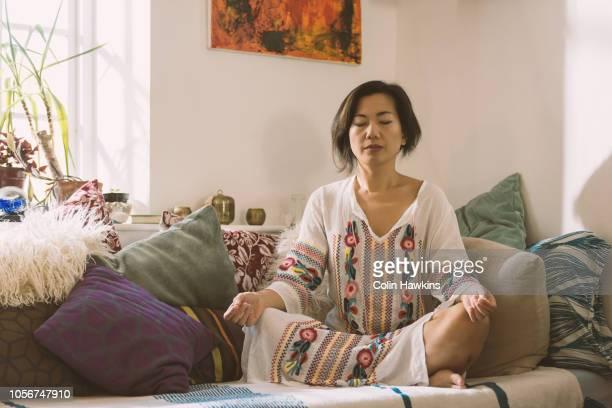 Chinese woman meditating