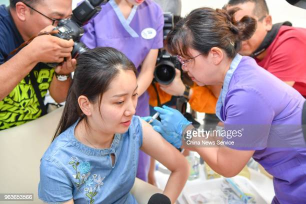 Chinese woman named Shi Jiayu from Beijing is injected with the 9valent Human Papillomavirus Vaccine against cervical cancer at Boao Super Hospital...