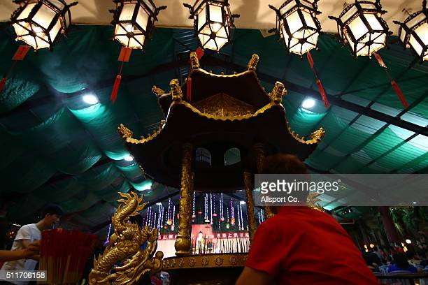 Chinese woman offers prayers at the Fo Guang Shan Dong Zen Temple to celebrate the Lantern Festival on the last day of Chinese Lunar New Year...