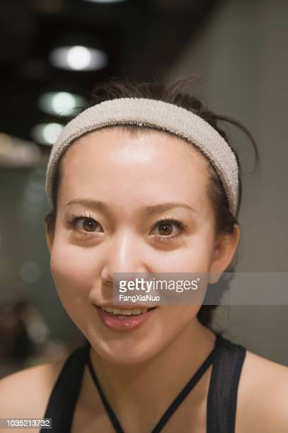 chinese woman portrait in gym - headband stock pictures, royalty-free photos & images