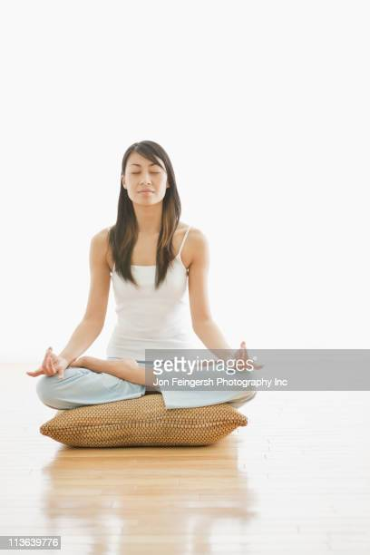 chinese woman practicing yoga - cross legged stock pictures, royalty-free photos & images