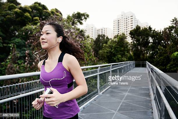 Chinese woman running with a smart phone