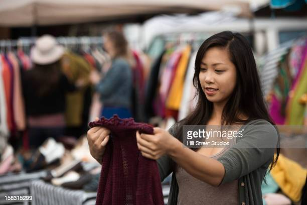 Chinese woman shopping at flea market