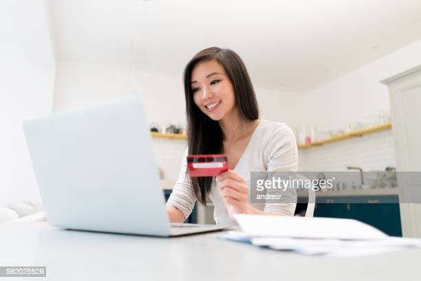 Chinese woman shopping online at home