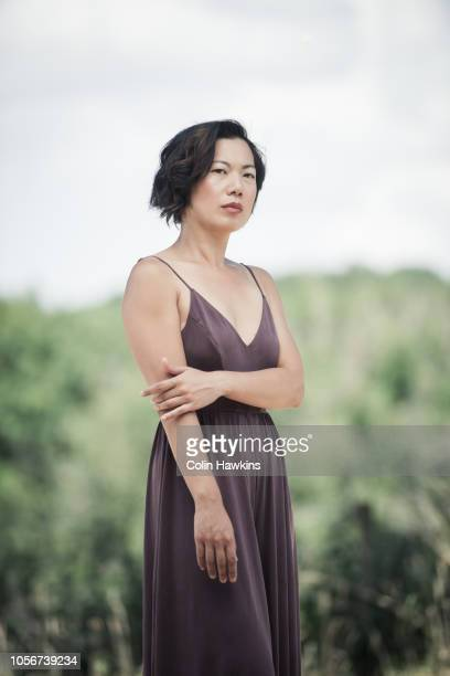 Chinese woman standing outside in summer dress