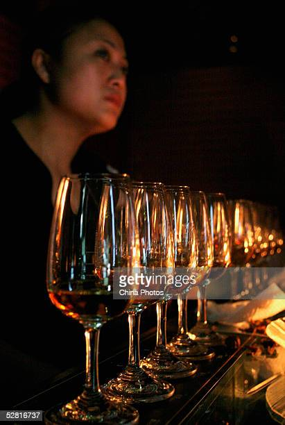 A Chinese woman tastes whisky at the Johnnie Walker Black Label Tasting Party on May 12 2005 in Chengdu of Sichuan Province China Johnnie Walker is...