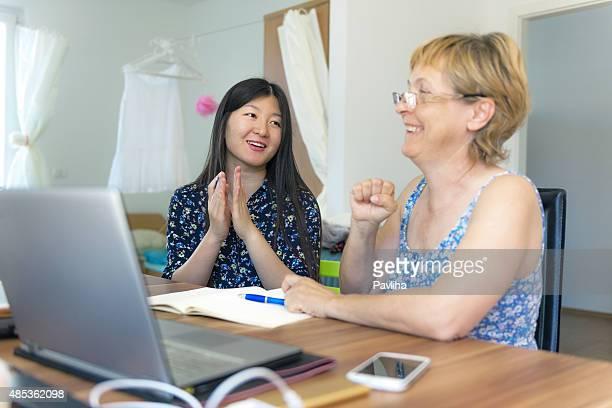 Chinese Woman Teaching Mature Female Caucasian Chinese Numbers, Slovenia, Europe