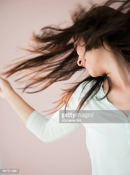 Chinese woman tossing her hair
