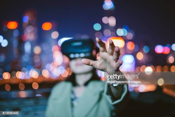Chinese woman using virtual reality headset