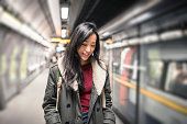 Chinese Woman waiting the metro