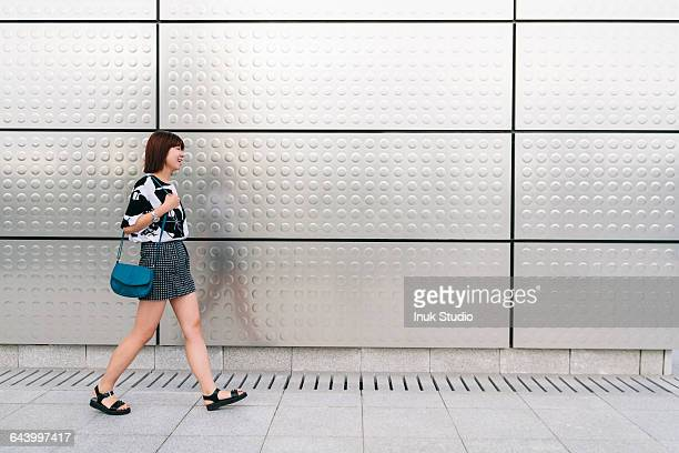 chinese woman walking on sidewalk - open toe stock pictures, royalty-free photos & images